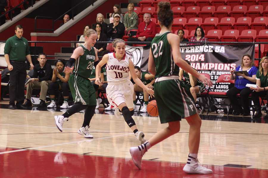 Kaylee Rekieta dribbles the ball across the court in a game against the Prosper Eagles.