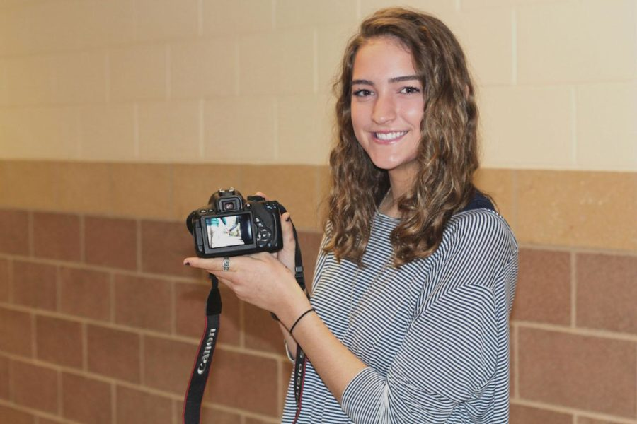 Maddie+Tober+is+using+her+Canon+digital+SLR+camera+to+capture+senior+portraits+for+her+senior+project.