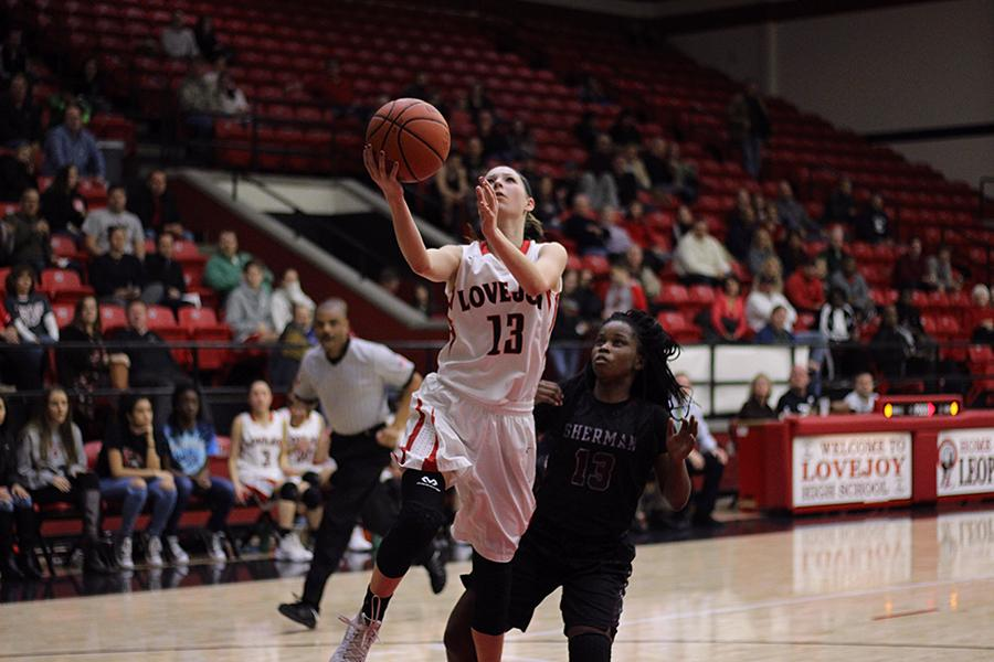 Taylor Meixelsperger takes shot against Sherman on Jan. 22. The girls basketball team is currently tied for the fourth in the district heading into the final regular season game.