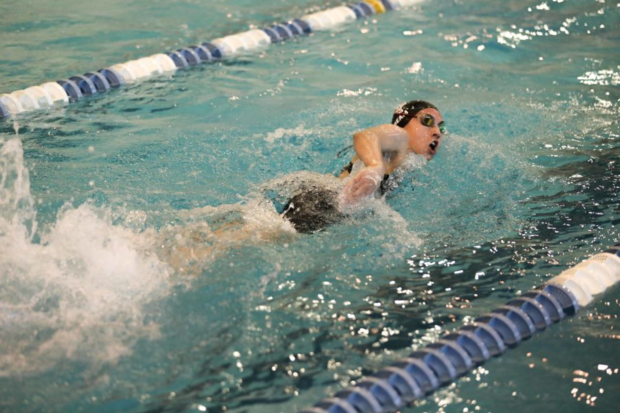 Junior Emma Ream swims her portion of the 400 yard freestyle relay that qualified for state out of regionals.