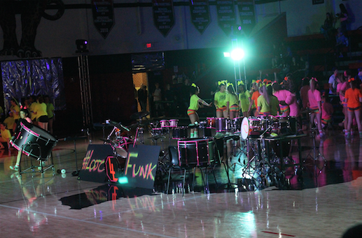 The+drum+line+set+up+and+decorated+their+drums+with+neon+duct+tape+for+their+performance.