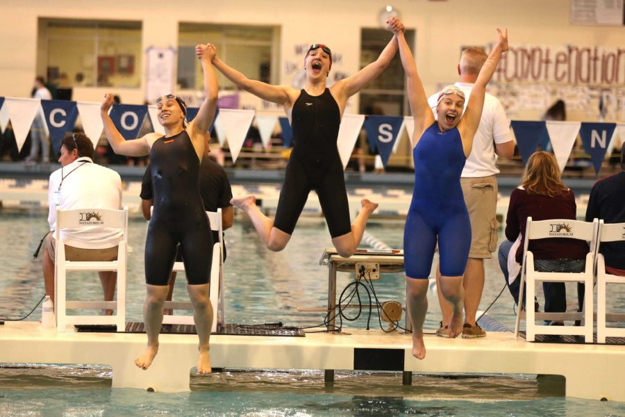 Three+members+of+the+girl%27s+400+freestyle+relay+team+celebrate+after+placing+second%2C+making+it+to+finals.+During+finals+the+following+day%2C+they+qualified+for+state.