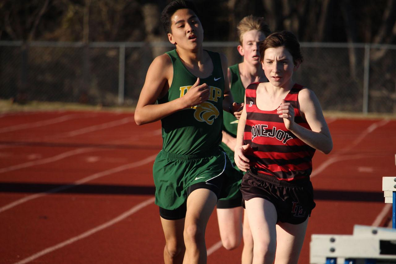 While running Varsity 3600, Collin Jones sprints past two UNHP racers.