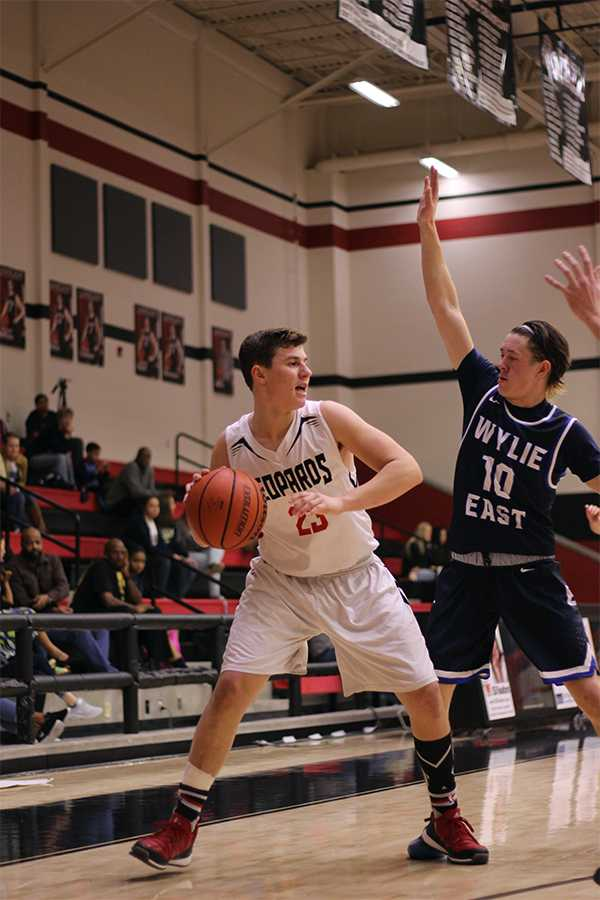 Freshman Michael DiFiore is a member of the varsity mens basketball team and freshman Lizzie Weichel plays for varsity soccer. Pictured above is DiFiore in a game against Wylie East.
