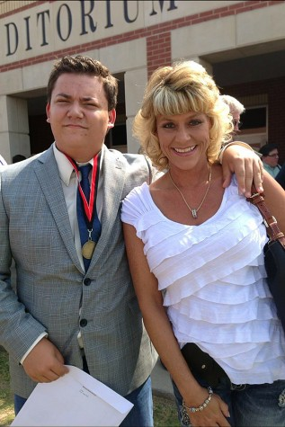Michelle Motsenbocker with son, Michael, in the courtyard at Lovejoy High School.