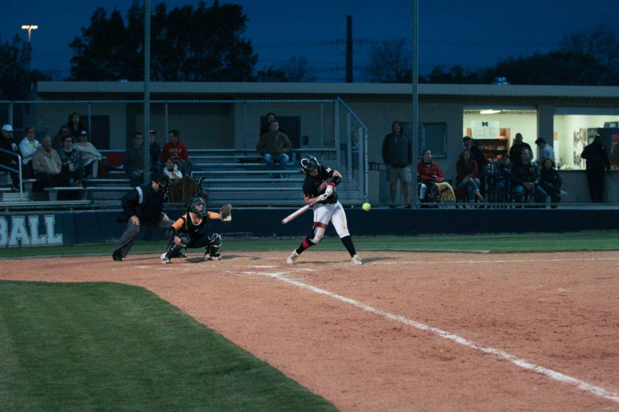 In+the+top+of+the+fourth+inning%2C+Alyssa+Difiore+%2813%29+hits+a+home+run.+While+it+was+a+solo+home+run%2C+it+started+off+a+nine+run+inning.