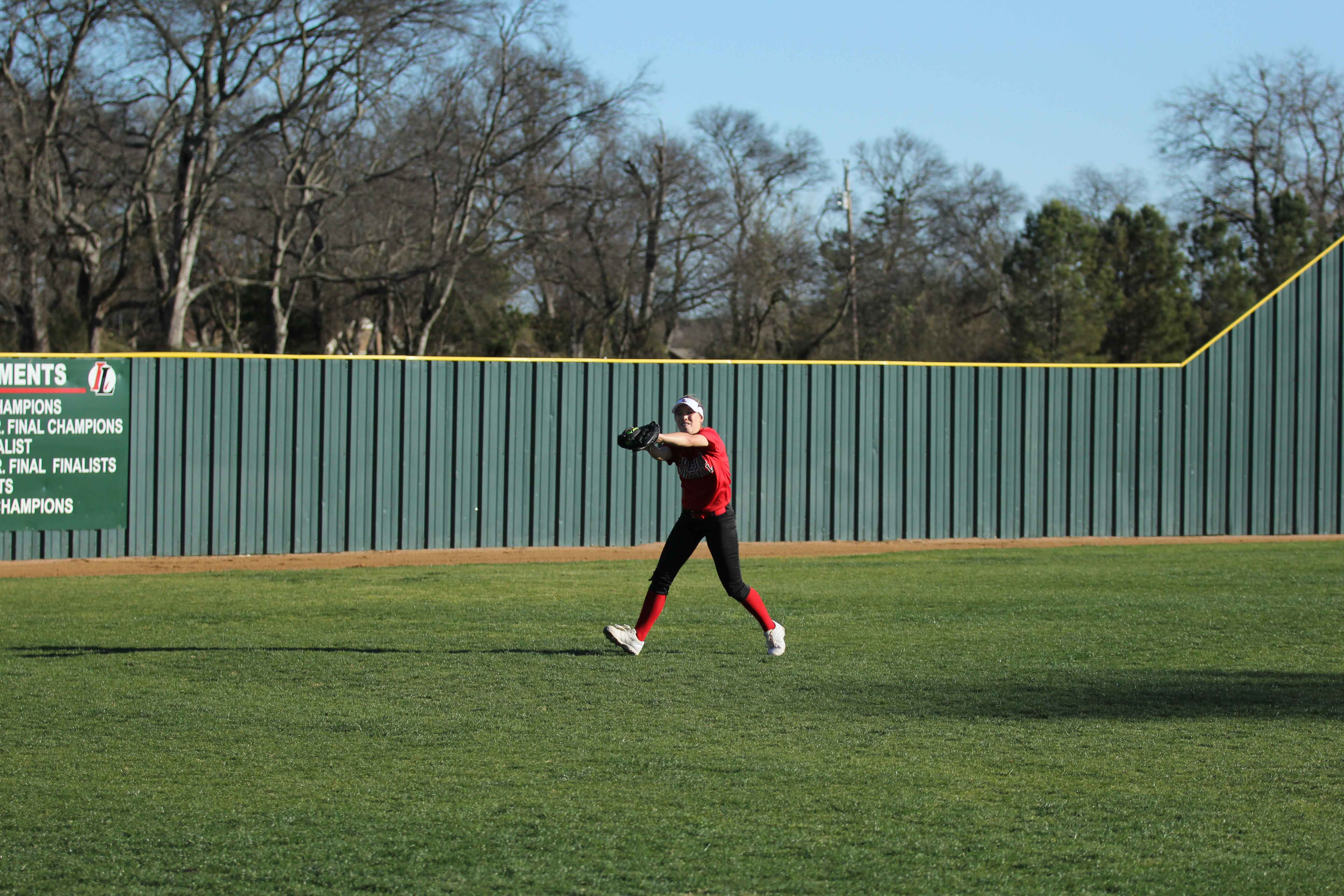 Alex Bellows makes a catch in the outfield during practice.