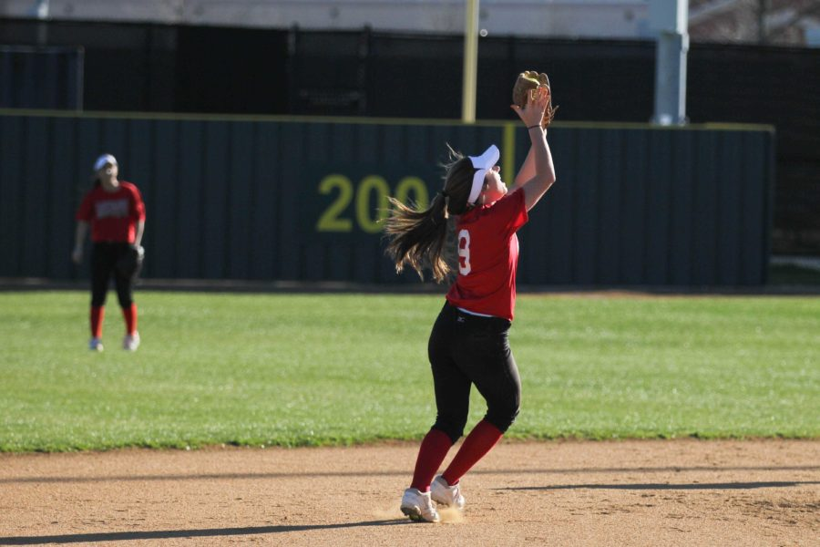 Junior+Emily+Weichel+makes+a+catch+in+the+infield+during+practice.+Whittle+has+been+playing+softball+since+third+grade.+