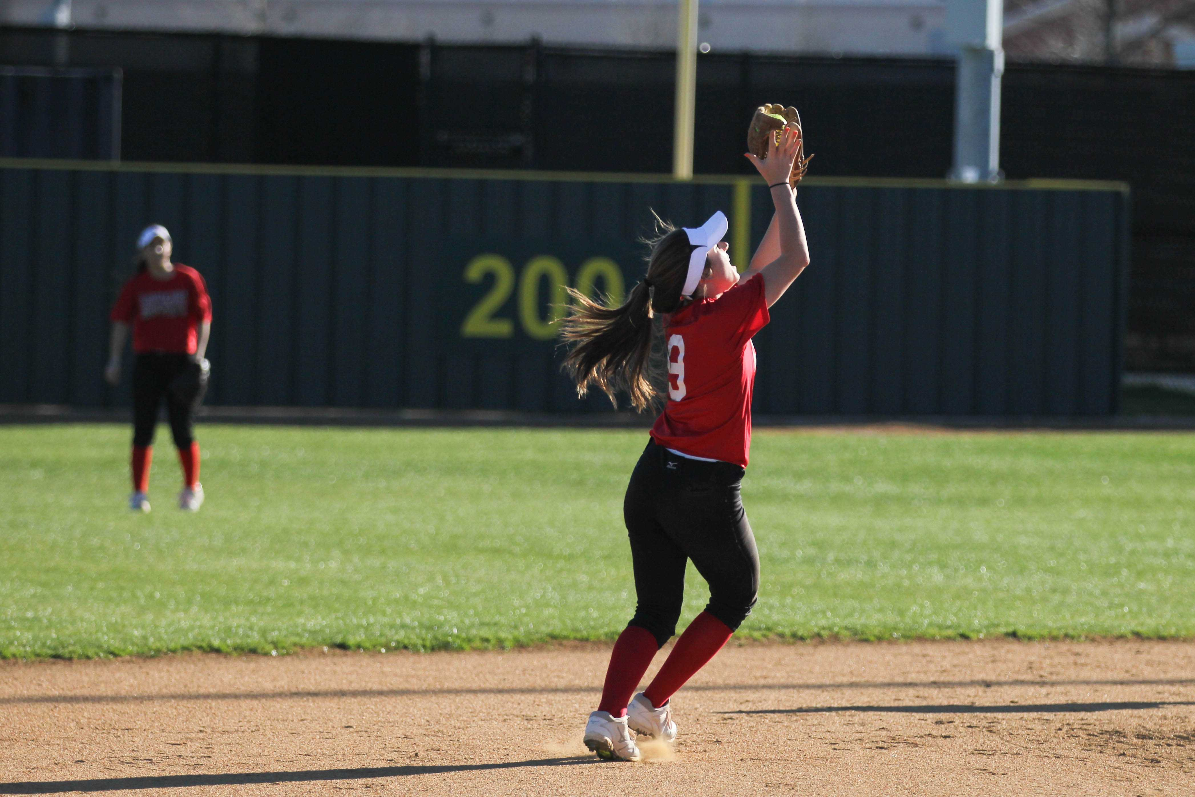 Junior Emily Weichel makes a catch in the infield during practice. Whittle has been playing softball since third grade.