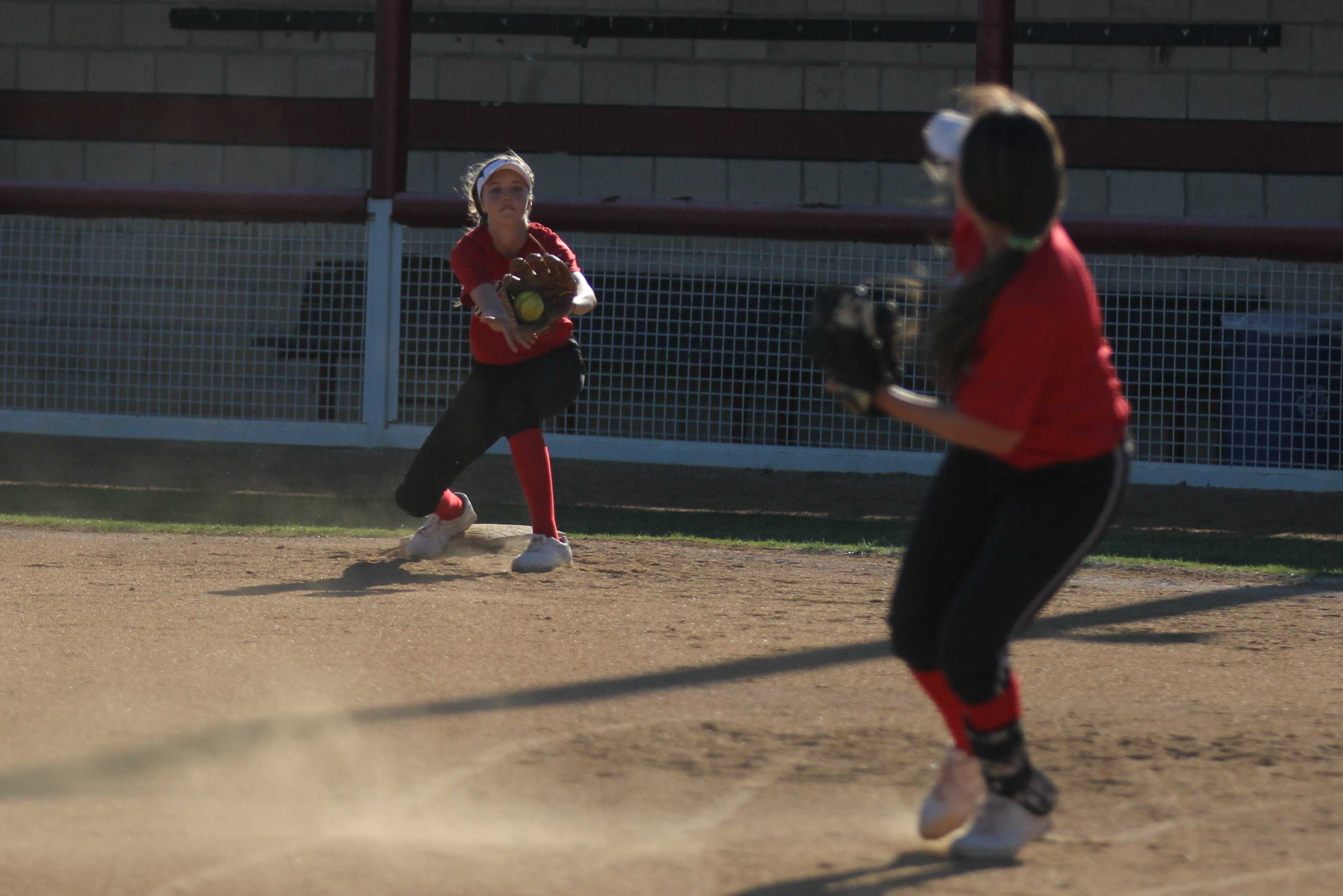 Rebecca Holliman practices covering first base in the week leading up to the McKinney tournament.
