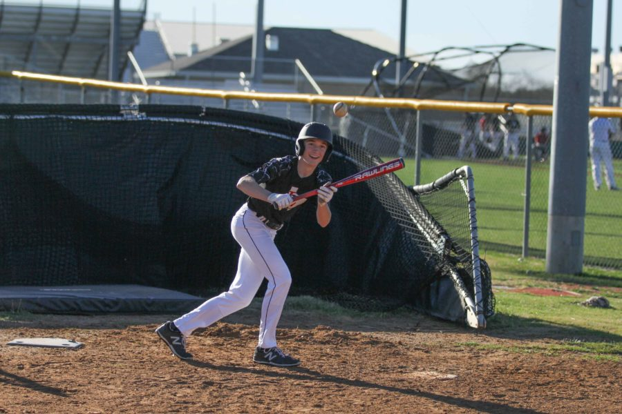 Reed Fraser practices bunting during the week leading up to a game.