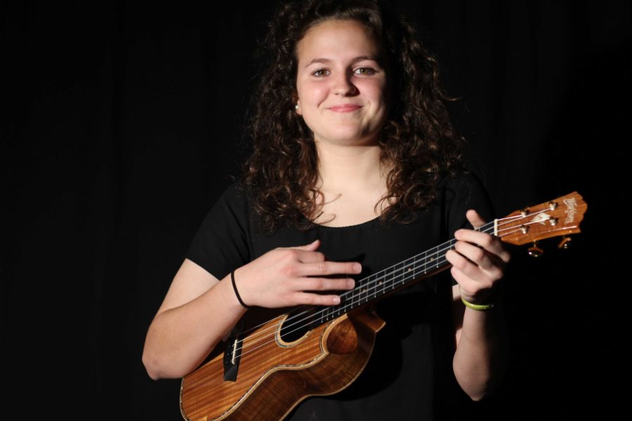 Junior Carolyn Murad spreads her passion of her small musical instrument, the ukulele to her students.