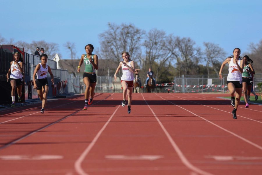 Grace+Ridgeway+runs+the+200+meter+dash+at+the+Lovejoy+Invitational+Track+Meet+held+before+the+district+meet.