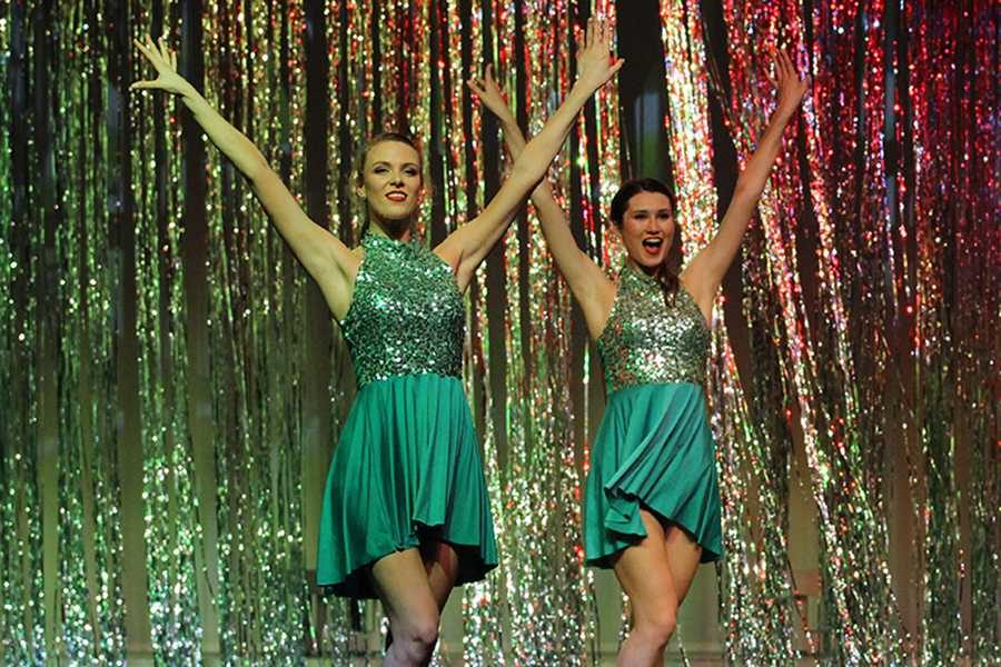 Seniors Aly White and Julia Vastano perform with their fellow seniors in a special dance.