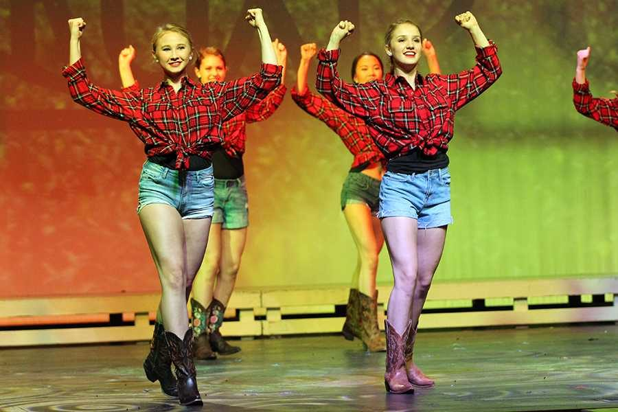 Sophomores Kate Morgan and Alyssa Whitmore perform in a Western themed dance.