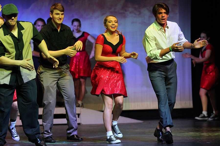 Senior+Portia+Gifford+dances+along+side+the+male+partners.