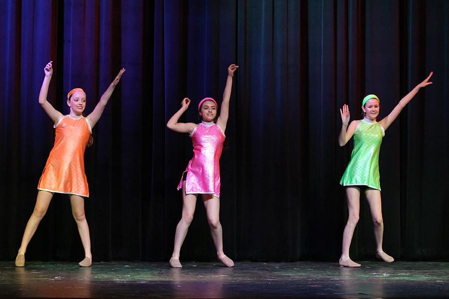 The Majestics team from Willow Springs Middle School performs a dance dedicated to the 1960s.