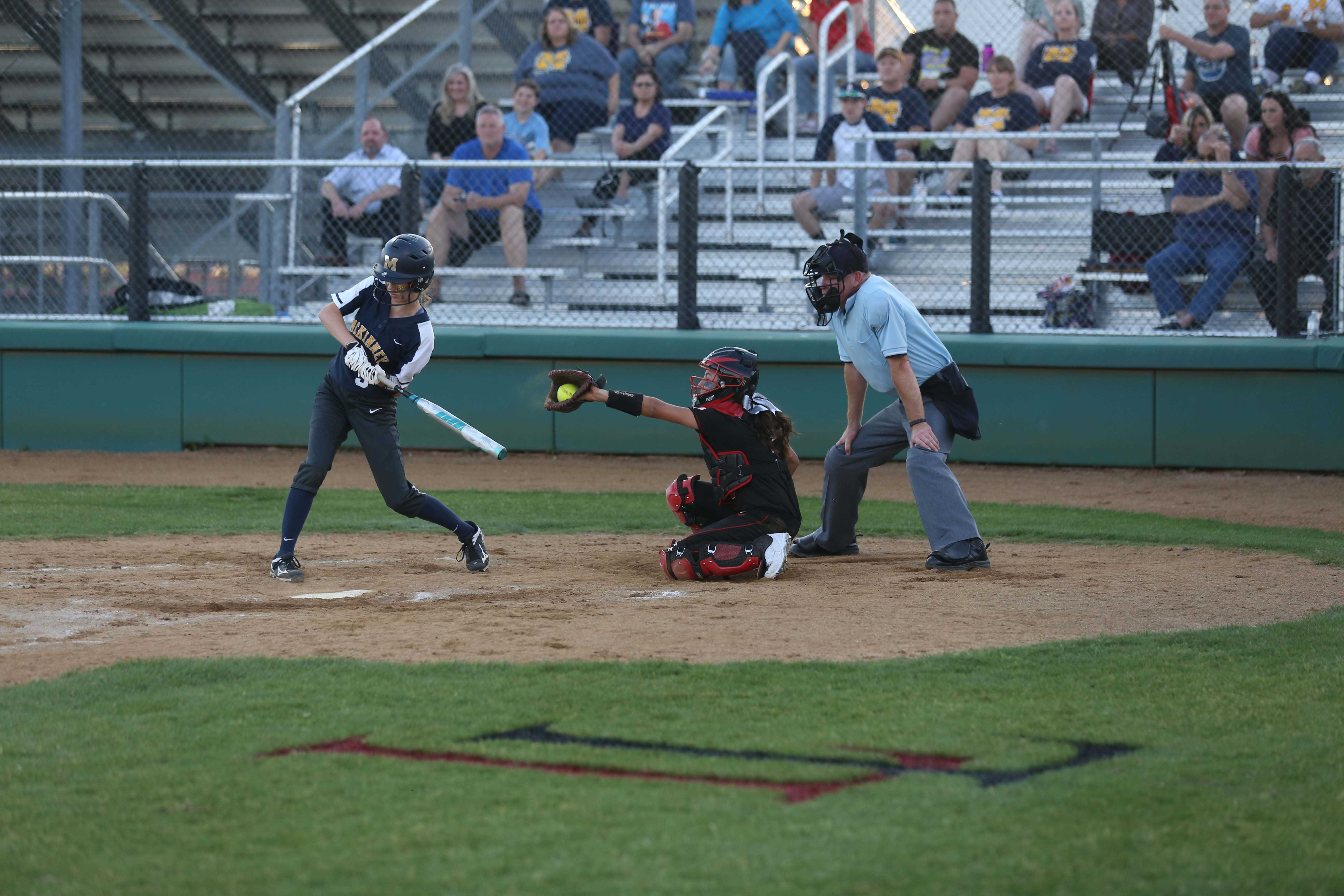 Celeste Soliz (5), behind the plate at last Friday's McKinney game, catches a strike. The softball team opens the playoffs tonight against The Colony.