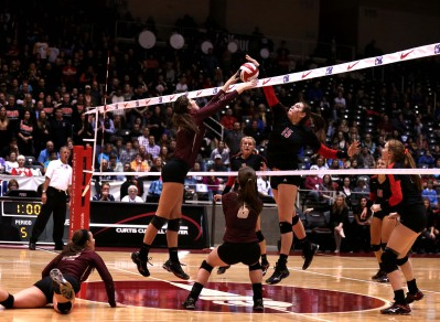 During the last state finals against Dripping Springs, TCU commit, Sarah Langs, hits an overpass as the middle blocker.