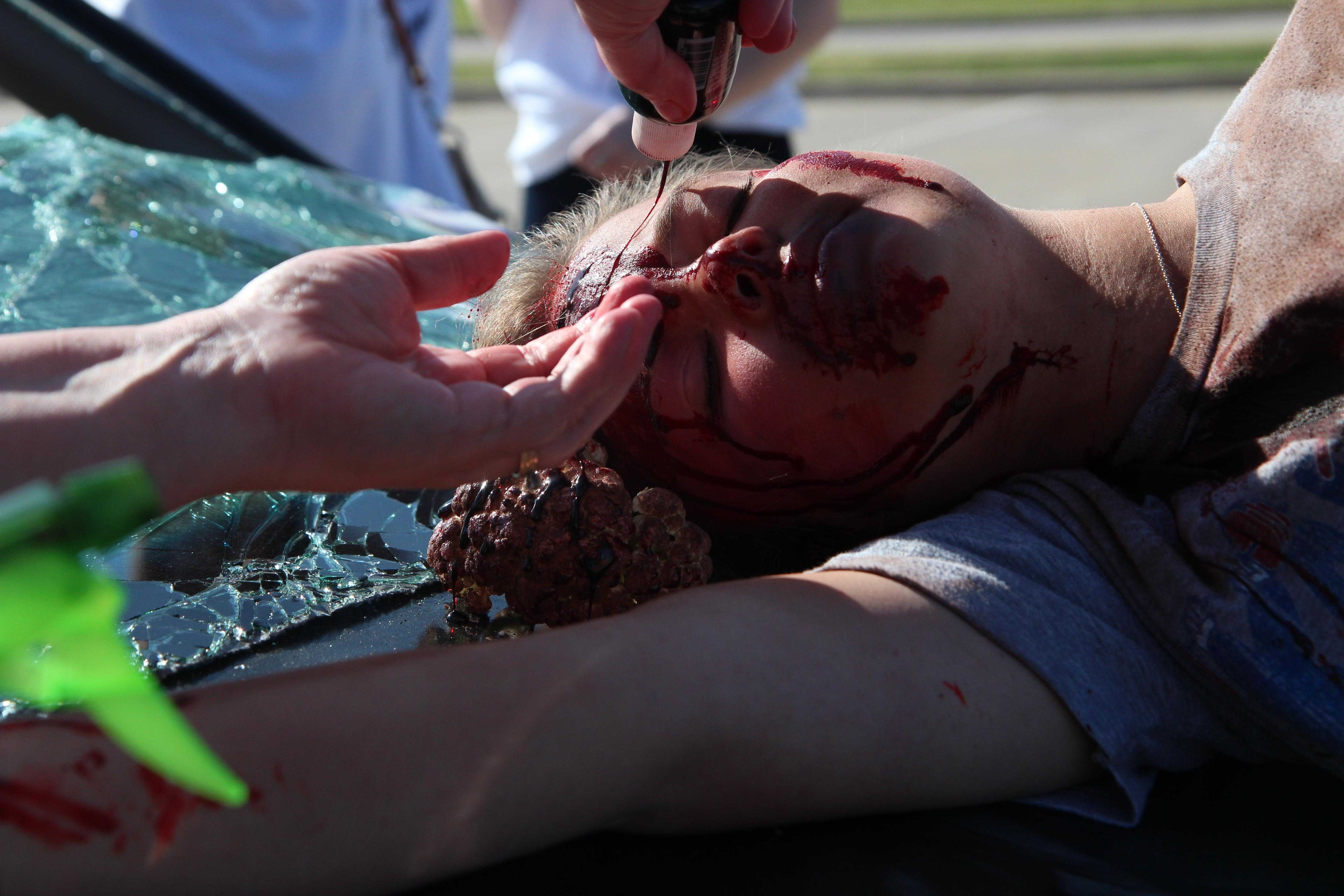 Shortly+before+students+finished+watching+the+video+inside%2C+final+touch+ups+were+done+on+the+makeup+of+the+crash+victims.