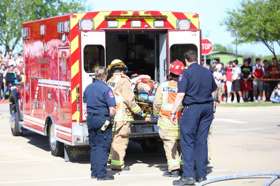 Riley Burnette, a junior at Lovejoy involved in the simulation, is loaded into an ambulance by the Lucas Fire Department. Lucas and Fairview were the two fire departments involved today.
