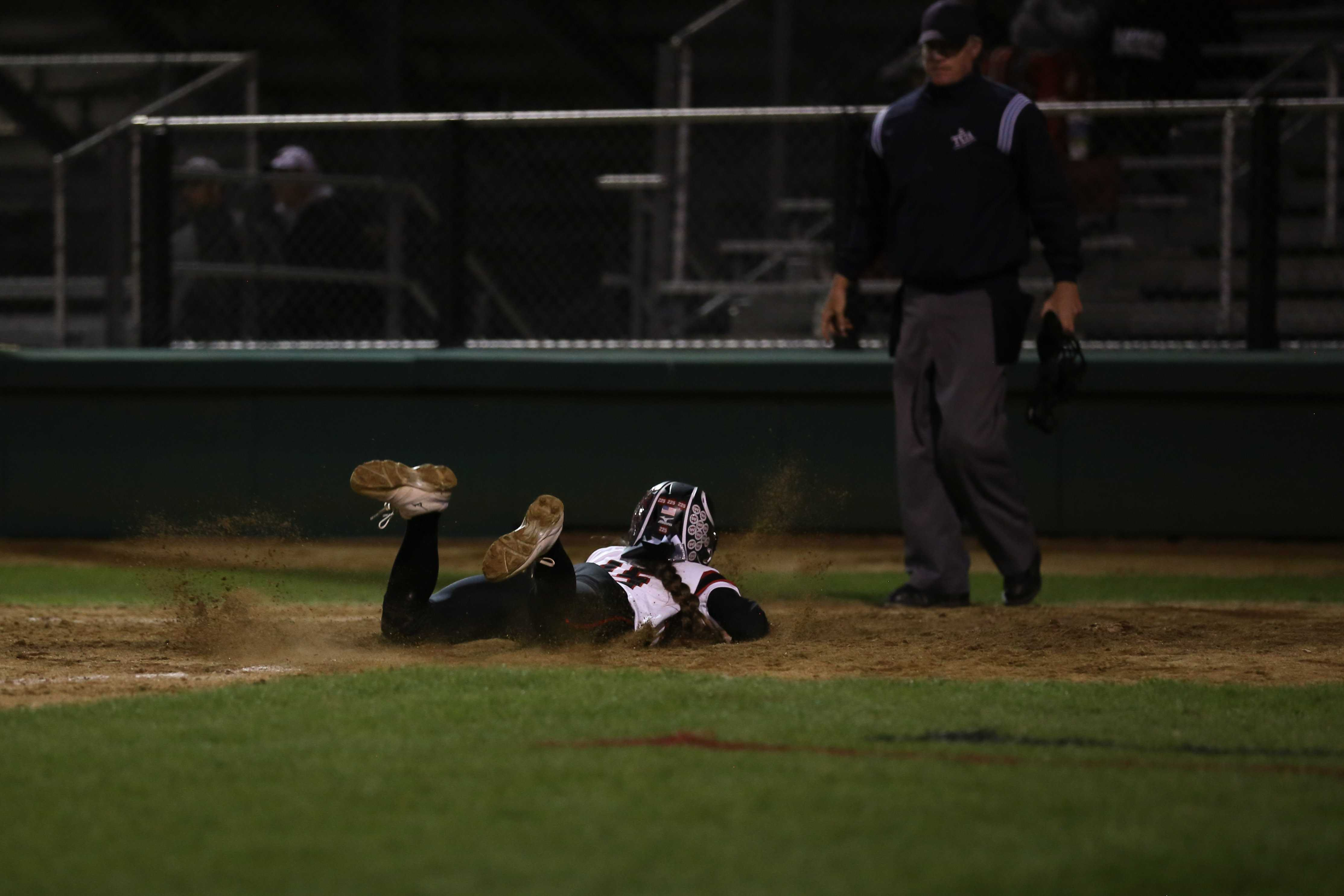 Junior Kylee Ramos (15) slides across home plate in the game against Wylie.