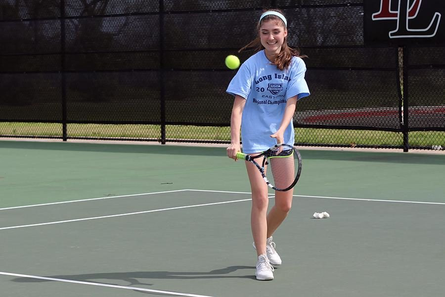 Sophomore and state qualifier Daniela Benigno hits with her teammates during practice.