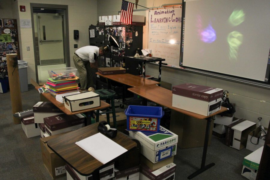 Animation teacher Ray Cooper is required to pack up and move his classroom due to expansions in E-hall and B-hall.