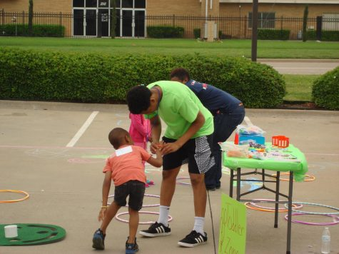 "Jalen Fields helps one of the young participants during his ""Get Fit 4 Christ Mini Sports Camp"" at LightChurch."
