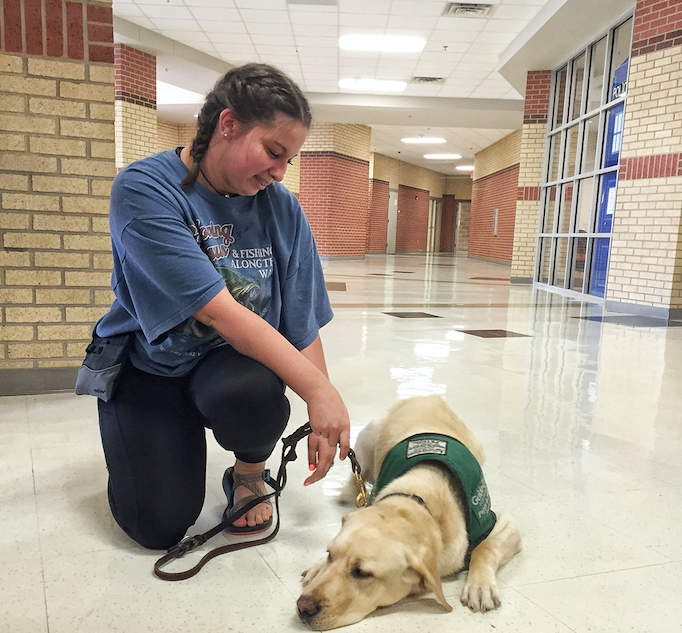 Junior Katie Sawyers with the guide dog named Salem. Salem will stay in Texas for basic training until he is 14-18 months old and then will complete his training on a Guide Dogs for the Blind campus.