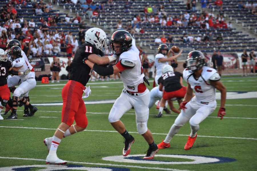 Senior receiver Anthony Vogel tries to get open for sophomore quarterback Carson Collins during the Tom Landry Classic game against Argyle.