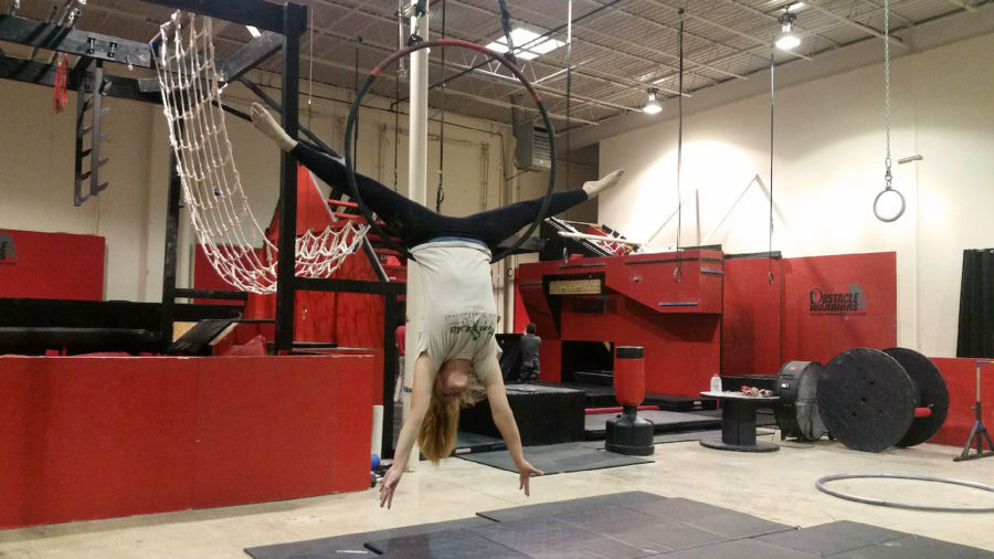 Despite suffering from vertigo sophomre Sophia Heussner trains at Lone Star Circus School near Richardson. She's pictured here using a lyra, an aerial hoop.