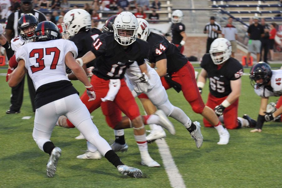 Junior+Landon+McDermott+attempts+to+tackle+an+Argyle+player+during+the+Tom+Landry+Classic+at+Allen+Eagle+Stadium.