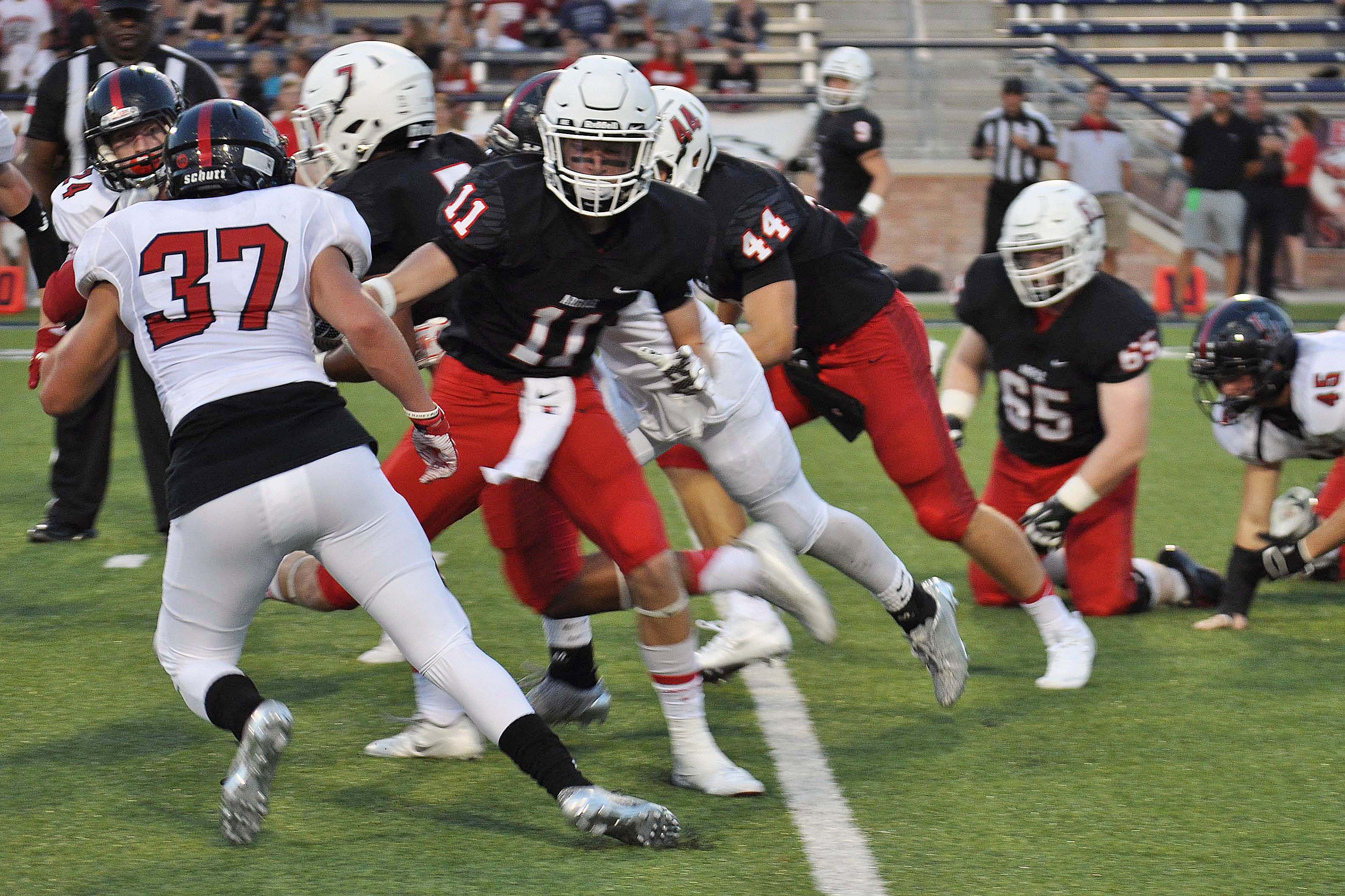 Junior Landon McDermott attempts to tackle an Argyle player during the Tom Landry Classic at Allen Eagle Stadium.