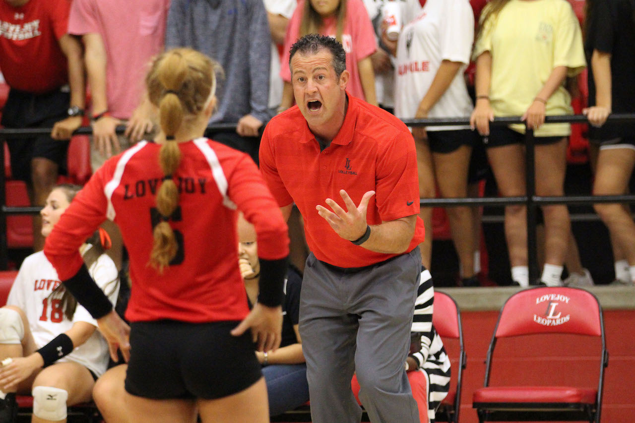 Head coach Jason Nicholson gives instructions to senior Lexie Smith during Tuesday's match. Volleyball will play Highland Park on Friday, projected to be the biggest district competition for the Leopards this season.