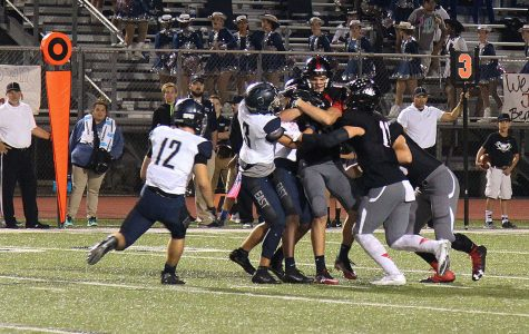 Football team battles for last chance playoff spot