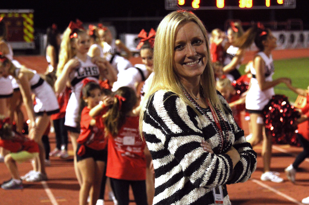 New cheer coach Shelly Wiggins has been coaching the sport for 20 years now. Wiggins moved to the district after previously working as a competitive cheer coach at a local gym.