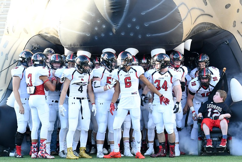 The football team prepares to race out of the Leopards mouth in front of the FNL crowd.