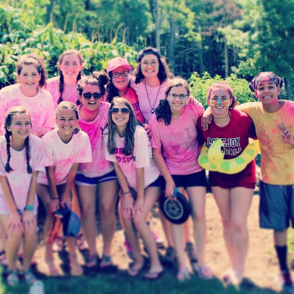 At Young Life camp in North Carolina this past summer, Jillian Sanders, Gabby Glorioso, Caroline Smith, Taylor Dismukes, Drew Dismukes, Meredith Vitanza, and CJ Bass pose after playing in a camp-wide volleyball tournament.