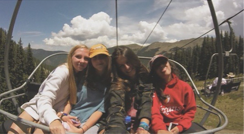 Freshman cross country members take a break on a ski lift in Taos while on their way to the top of the mountain. Once at the top, the team went on a hike.