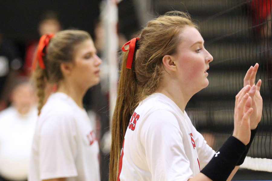 Senior Haley Deschenes is awaiting the opposing teams serve to her side of the court.