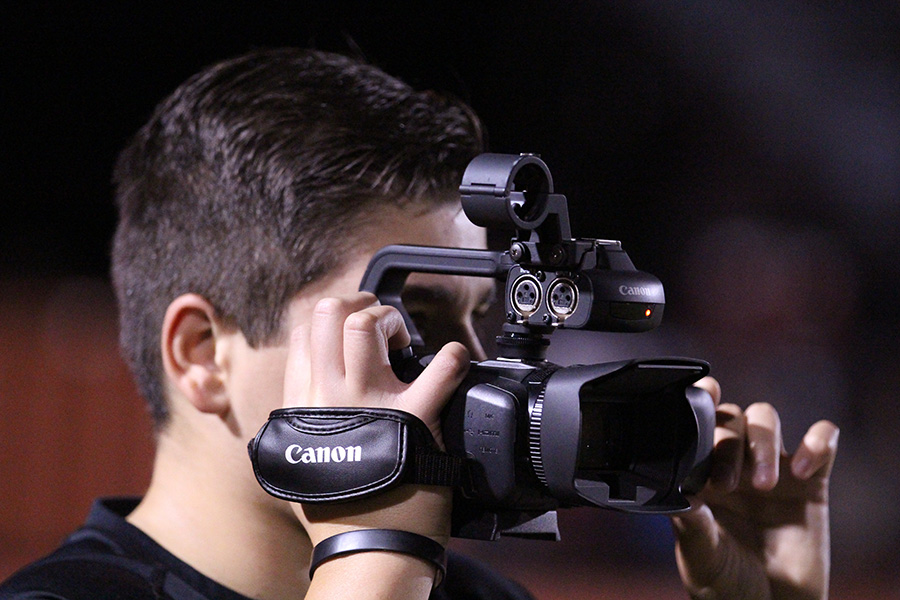 Junior Michael Ray has a unique view of the gridiron: through the lens of a video camera.