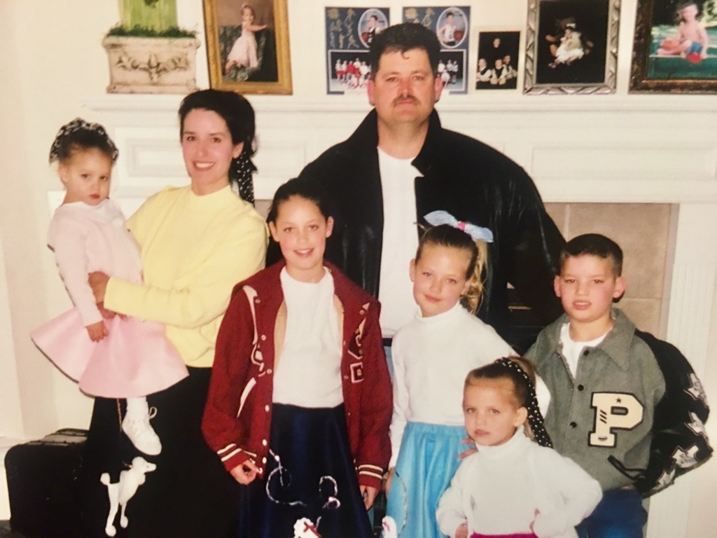 The entire Ray family dressed up for Lovejoy Elementary's 50's Sock Hop Family Night in 2002.