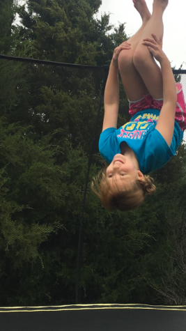 Mallory jumping on her trampoline for the first time since her diagnosis.