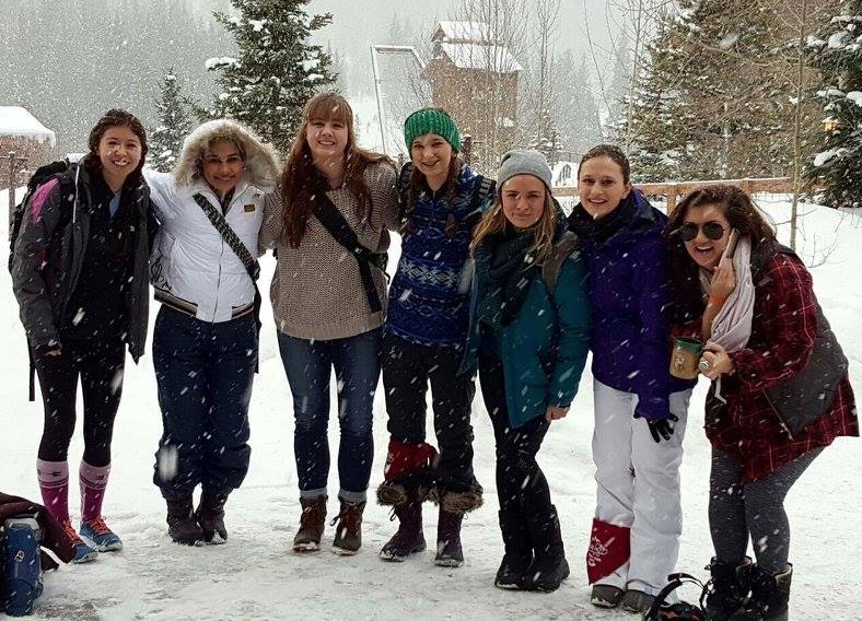 Ellie+Hager%2C+Jillian+Sanders%2C+Katy+Park%2C+and+Allen+Younglife+students+pose+at+the+basin+of+the+Winter+Park+Ski+Resort+on+last+year%27s+ski+trip.+