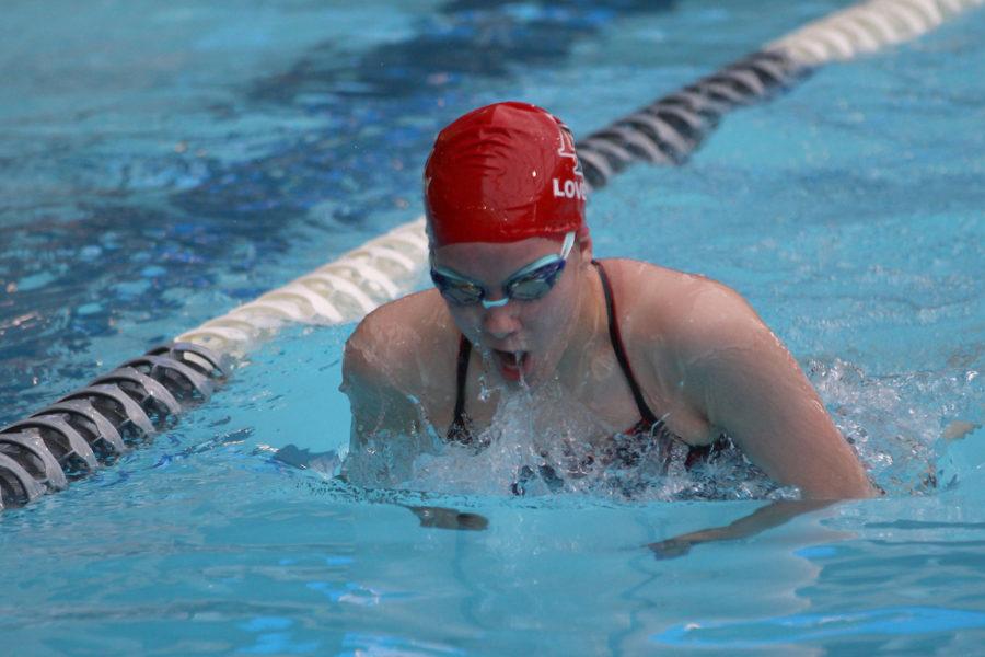 Freshman Jackie Carroll races in the breaststroke race.