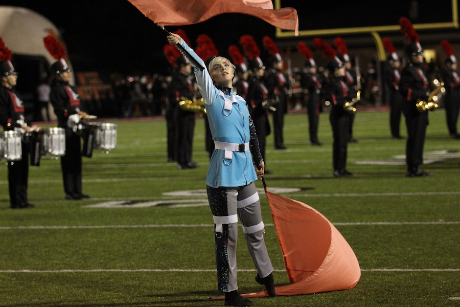 Even though football season is over, the color guards, including Madeleine Hamilton, are continuing to preform.