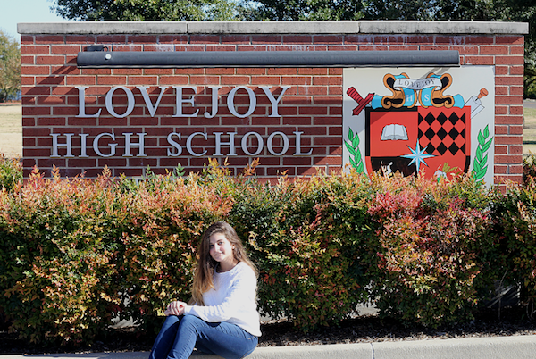 Hannah D'Iorio sits in front of the LHS school sign