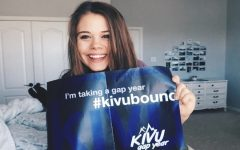 Ellie Stockton holds her acceptance poster from the KIVU Gap Year Program