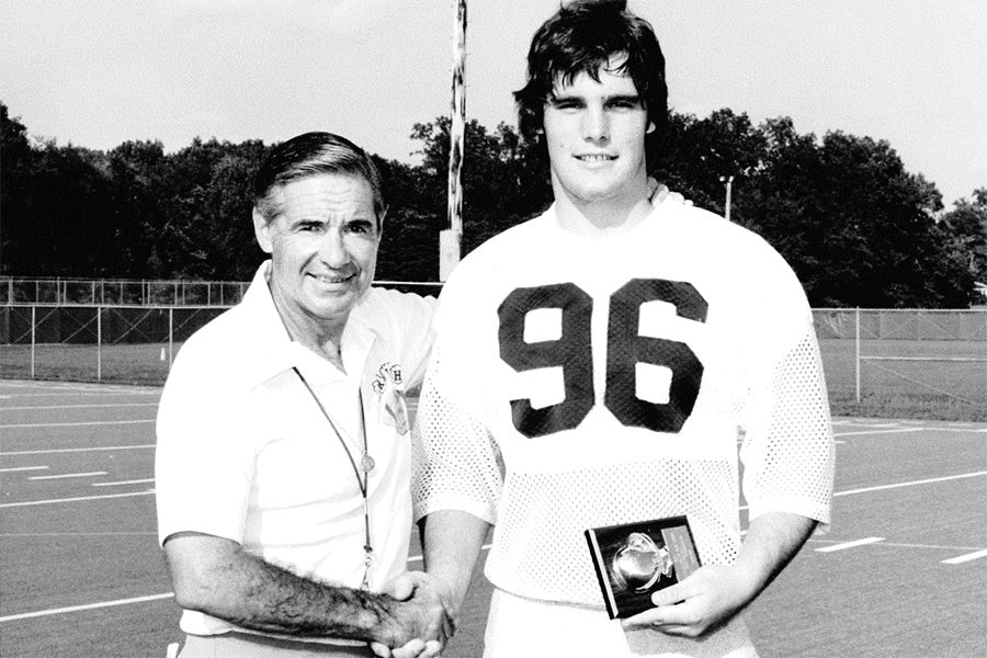 Kenneth Muncy receives a JV defensive player of the week award from Notre Dame head coach Dan Devine on Sept. 6, 1980. Muncy, now a Spanish teacher at the high school, played defensive end for the Fighting Irish.